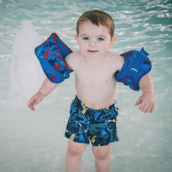 Ezra and his floaties at the water park.